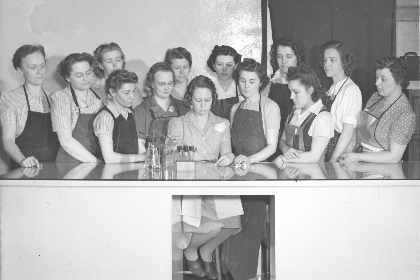 Oliver I M Co. Women working in iron ore lab. Apr. 1943